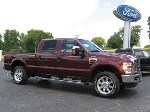 Photo 2009 Ford F250 4x4 Crew Cab Lariat